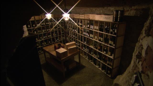 Bottles of wine stock a restaurant wine cellar.