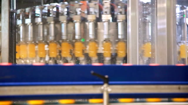bottles on conveyor belt in factory - bottling plant stock videos and b-roll footage