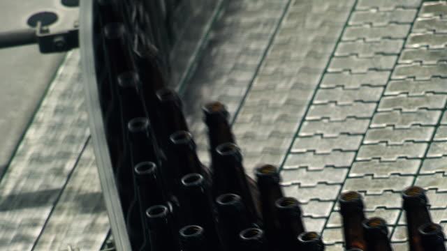 bottling of beer. stralsund, germany - beer bottle stock videos & royalty-free footage