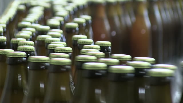 cu bottling plant of making beer inside brewhouse  / grafenhausen, baden-wuerttemberg, germany - bottling plant stock videos and b-roll footage