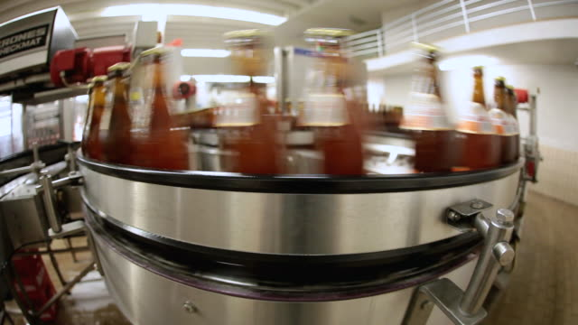 ms bottling plant of making beer inside brewhouse  / grafenhausen, baden-wuerttemberg, germany - bottling plant stock videos and b-roll footage