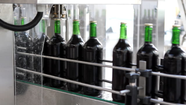 bottling plant (hd) - food and drink industry stock videos and b-roll footage
