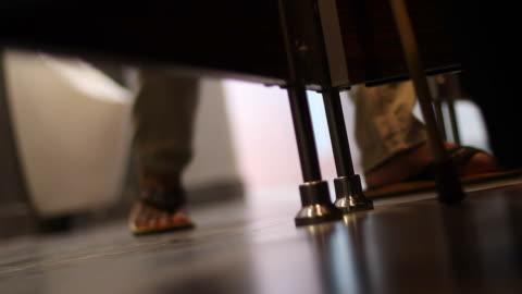 bottom corner under the bathroom door with foot walk. - bathroom stock videos & royalty-free footage