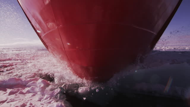bottom of icebreaker sailing through antarctic ice floes - antarktis stock-videos und b-roll-filmmaterial