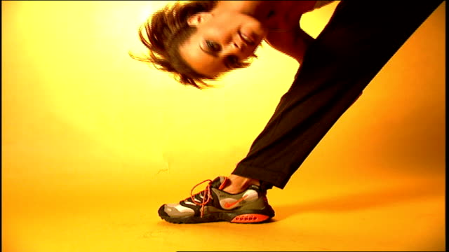 cu bottom of silver nike shoes with neon laces - nike designer label stock videos and b-roll footage