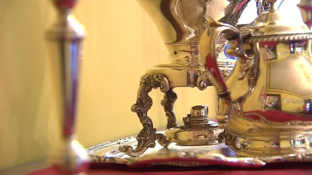 bottom of silver tea kettle on october 15 2013 in chicago illinois - tea kettle stock videos & royalty-free footage