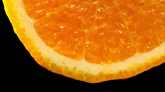 bottom orange healthy choice with black background - ascorbic acid stock videos & royalty-free footage