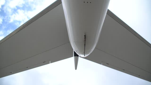 bottom view of a private jet - tail stock videos & royalty-free footage