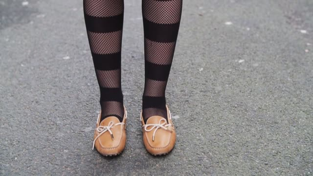 Bouchra Benhalima Bouasria blogger from Boubou Tea Time wears an HM cap an HM dress a Farah Asmar bag Tods beige shoes Calzedonia striped tights a...