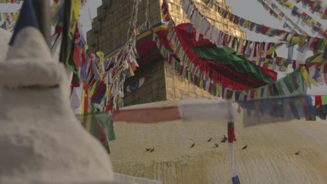 boudanath temple and prayer flags - eskapismus stock-videos und b-roll-filmmaterial