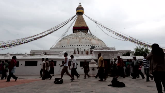 ws boudhanath ancient stupa structure containing buddhist relics golden spire w/ painted eyes of buddha flock of birds flying landing on white dome... - stupa stock videos & royalty-free footage