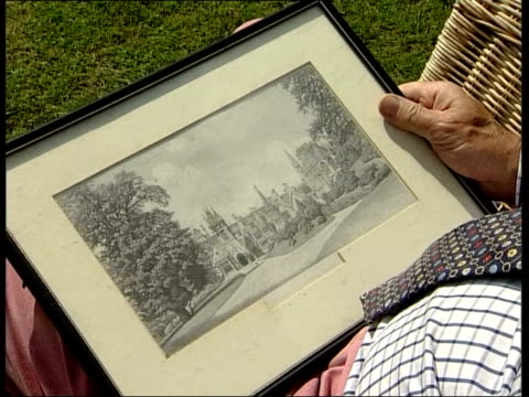 bought by national trust; itn ext antony woodall sitting in garden looking at picture of tyntesfield house antony woodall interviewed sot - it was a... - tyntesfield点の映像素材/bロール
