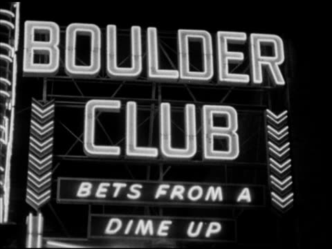 night 'boulder club bets froma dime up' neon sign w/ chevrons 'here it is the famous pioneer club' sign w/ 'vegas vic' head vertical 'gambling' sign... - dime stock videos and b-roll footage