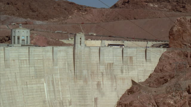 ms boulder dam with traffic on top of dam / nevada, arizona, usa - hoover dam stock videos and b-roll footage