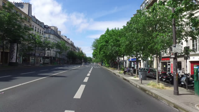 boulevard beaumarchais with only three pedestrians and without traffic may 03 2020 in paris france - three people stock videos & royalty-free footage