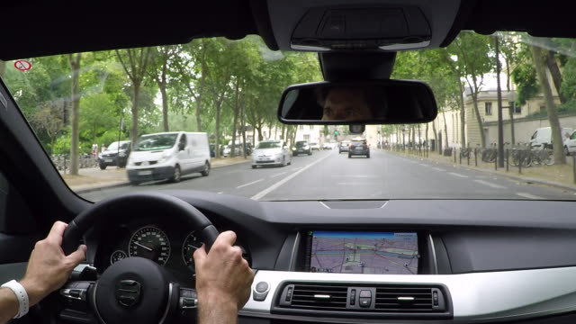 boulevard des invalides .inside car driving pov. - car interior stock videos & royalty-free footage