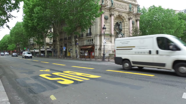 may 11:boulevard saint michel with provisional cycle path, on may 11, 2020 in paris, france. france has started a progressive relaxation of its... - boulevard video stock e b–roll