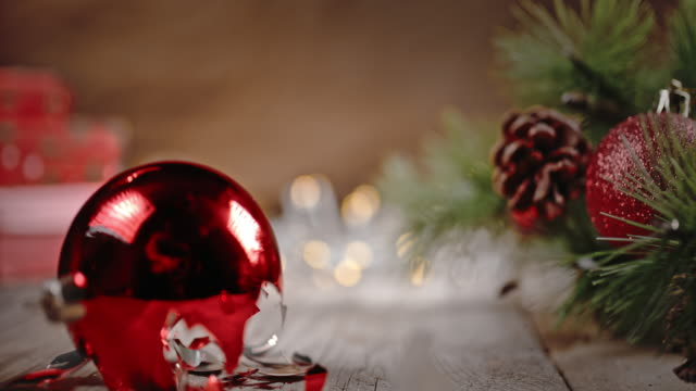 slo mo bouncing christmas ball crushed into pieces - christmas tree stock videos & royalty-free footage