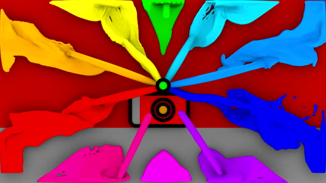 bouncing digital camera flashing colorful paint splashes - digital camera stock videos and b-roll footage