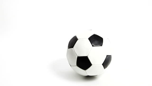 bouncing football -soccer. isolated on white. - ball stock videos and b-roll footage