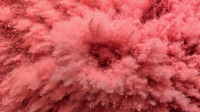 bouncing off a surface filled with pink red colored powder and creating smoky texture in close up and super slow motion - 粉紅色 個影片檔及 b 捲影像