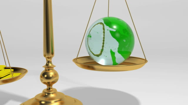 cgi bouncing scale tray with rotating crystal globe and bars of gold - 正義の天秤点の映像素材/bロール