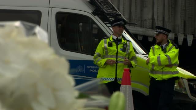 bouquets of flowers left at the scene of the london bridge and borough market terror attacks - überfahren stock-videos und b-roll-filmmaterial