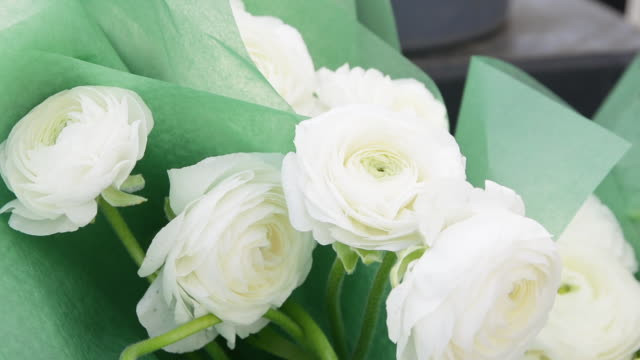Bouquets of white ranunculus flowers at market