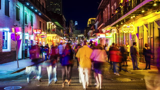 bourbon street at night in the french quarter of new orleans, louisiana - time lapse - new orleans stock videos and b-roll footage