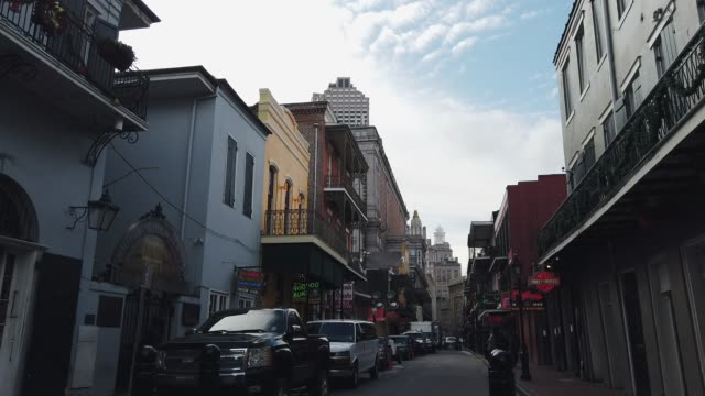 bourbon street (shops and bars) in the french quarter of new orleans during the day - new orleans stock videos & royalty-free footage