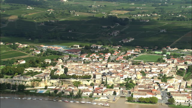 aerial, bourg on banks of dordogne river, aquitaine, france - aquitaine stock-videos und b-roll-filmmaterial