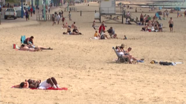 bournemouth beach gvs; england: dorset: bournemouth: ext gvs bournemouth beach with people including groups of young people and families, people... - family stock videos & royalty-free footage