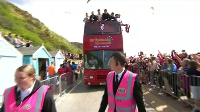 bournemouth celebrate promotion to premier league england dorset bournemouth ext bournemouth football team on top deck of open top bus during parade... - bournemouth england stock videos & royalty-free footage