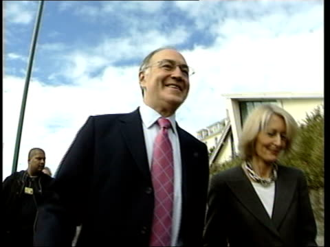 bournemouth ext conservative party leader michael howard and wife sandra howard along from hotel as photographed by press timetable for action sign... - bournemouth england stock videos & royalty-free footage