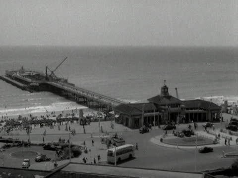 bournemouth pier stretches out into the sea. - bournemouth england stock videos & royalty-free footage