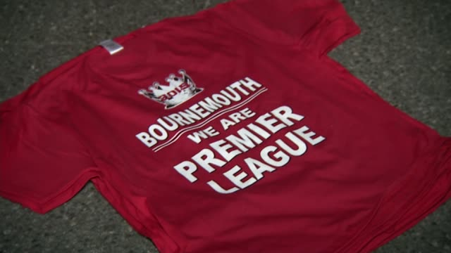 fans before and after match after fans buying commemorative shirts with slogan 'bournemouth we are premier league' / man celebrating / man selling... - top garment stock videos & royalty-free footage