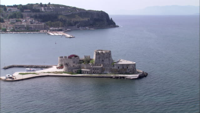 bourtzi castle stands on an island in the nauplion harbor. - castle island stock videos & royalty-free footage