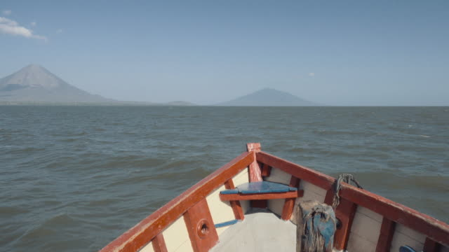 bow of an old boat. aproaching to ometepe island in nicaragua, crossing cocibolca lake. two volcanoes (madera and concepcion) on the foreground. - ship's bow stock videos and b-roll footage