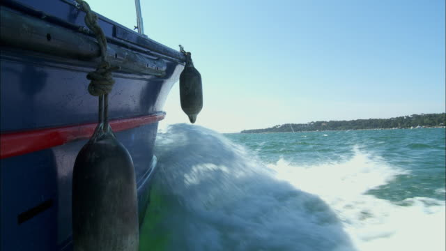 bow of boat - mooring buoy - right side - wake in the water - buoy stock videos & royalty-free footage