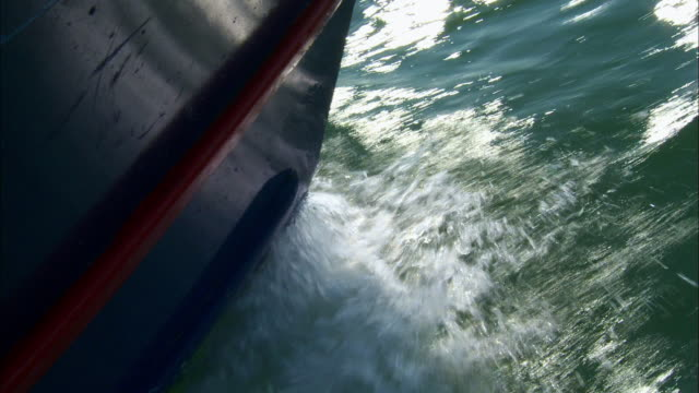 Bow of boat - Mooring buoy - Wake in the water