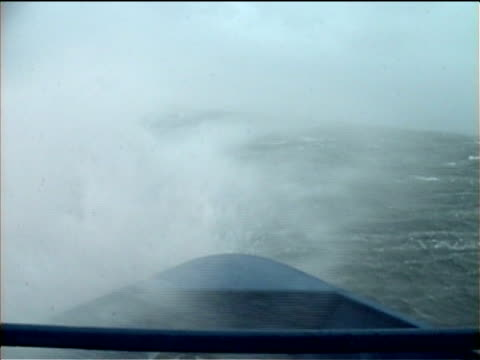 pov, bow of boat on large waves rolling and cresting on stormy sea, bering sea, alaska, usa  - rough stock-videos und b-roll-filmmaterial