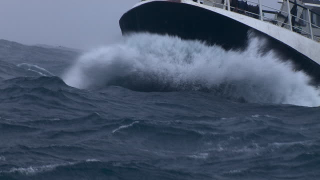 bow of fishing trawler on rough ocean, scotland, uk - water stock videos & royalty-free footage