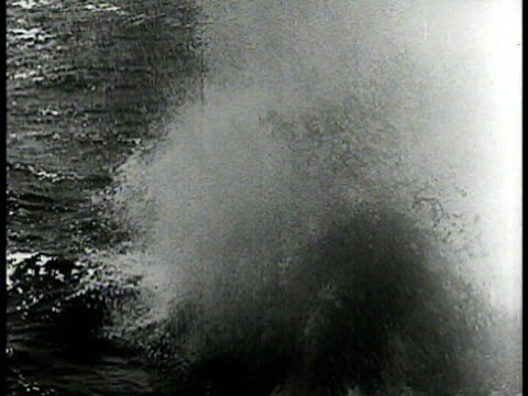 bow of german submarines at sea ms torpedo launching into water ws us battleship damaged at sea ha ws survivors on lifeboat ms ship upright sinking... - sinking stock videos & royalty-free footage