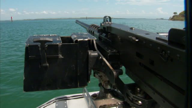 browning .50 caliber machine gun & ammo box w/ harbor shoreline bg. anti-terrorism, safety, security, defense, port, naval, navy base. - guantanamo bay stock videos & royalty-free footage