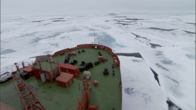 pov, bow of russian nuclear icebreaker traveling through broken pack ice, russia - ship stock videos & royalty-free footage