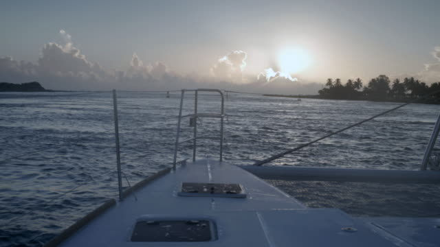 bow of sailboat moving forwards towards sunrise - boat point of view stock videos & royalty-free footage