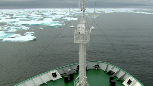 ms ha bow of ship crossing sea covered with ice floes, nunavut, canada - northwest passage stock videos and b-roll footage
