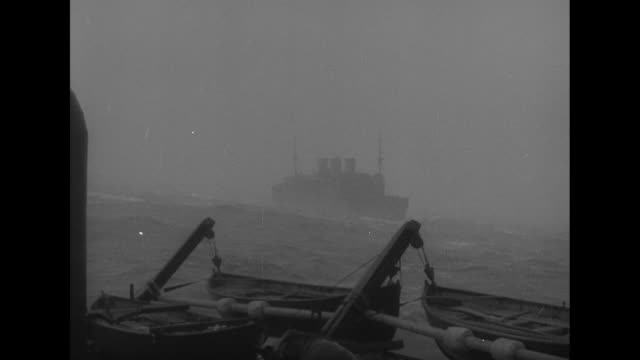 bow of ship heaving in heavy waves; torrents of water pouring over soldiers huddled on deck; ship seen in the distance past lifeboats / man with... - wwi tank stock videos & royalty-free footage