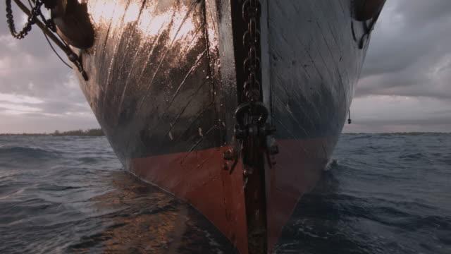 bow of tall ship at anchor in bay, grenada - ship's bow stock videos & royalty-free footage