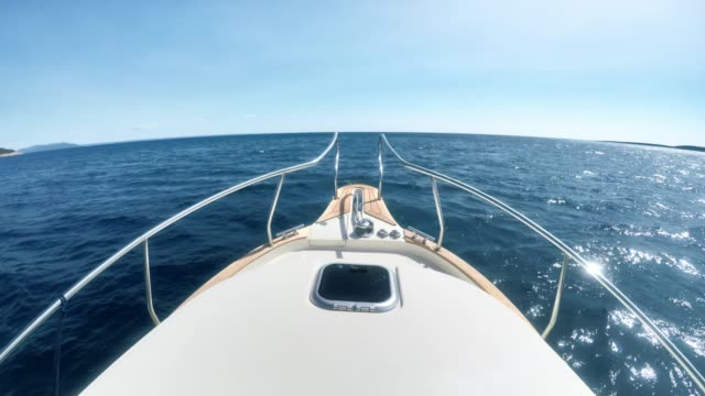 ld bow of the boat  moving and cutting through waves in sunshine - boat point of view stock videos & royalty-free footage